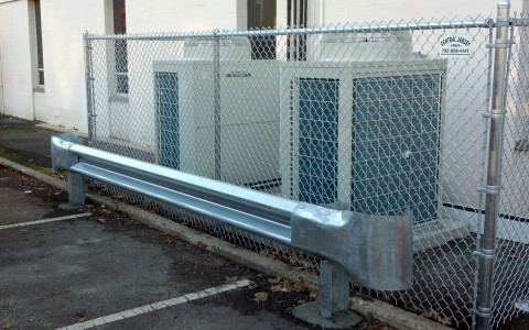 Chain Link Enclosure with Guard Rail Barrier